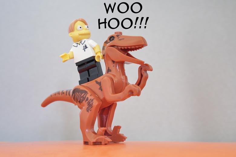 enjoying the ride on a dinosaur!
